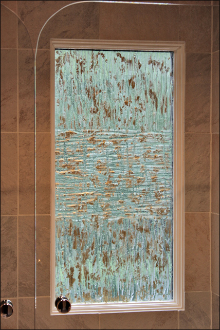 Cast glass privacy window with gold leaf detail for a residence in Alexandria, VA