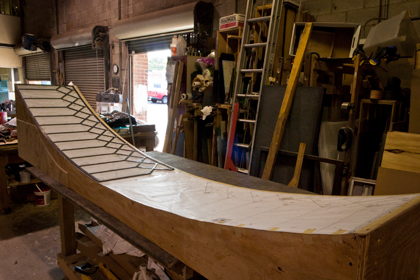 Wooden template for curved leaded glass